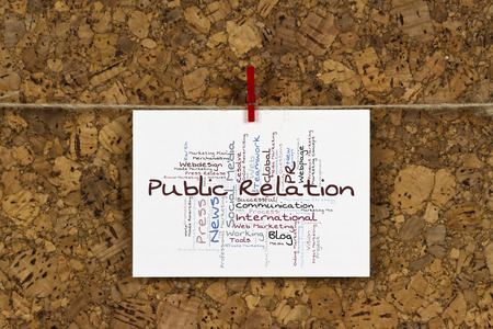 public relation: Public Relation word cloud on business card pinned up on cork board