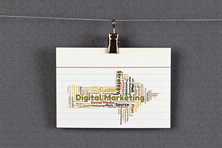 Digital marketing word cloud on a business card pinned up on stock digital marketing word cloud on a business card pinned up on a board stock photo reheart Images