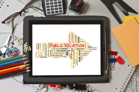 public relation: Public Relation word cloud shaped as a arrow to the right on a tablet screen