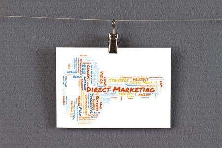 Webl marketing word cloud on a business card pinned up on a board 65627930 direkt marketing word cloud shaped as a key on a business card pinned up on a board colourmoves