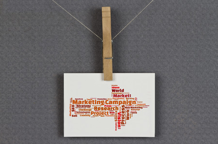 metadata: Marketing Campaign word cloud on a business card pinned up on a board Stock Photo