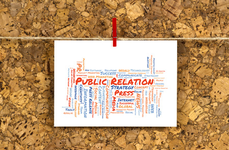 public relation: Business card with Public Relation word cloud shaped as a arrow to the right on a cork pinboard