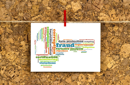 mitigation: Business card with FRAUD word cloud shaped as a arrow to the right on a cork pinboard