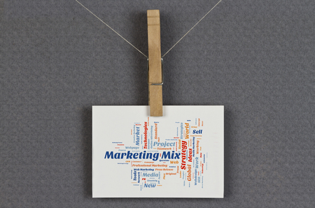 marketing mix: Marketing Mix word cloud on a business card pinned up on a board