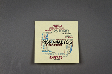 risk analysis: note pad with risk analysis word cloud shaped as a stop sign on a pinboard
