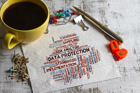 escalation: concept of data protection word cloud on a napkin with pen and cup of coffee