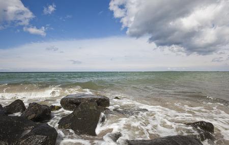 Waves hitting stones on the beach