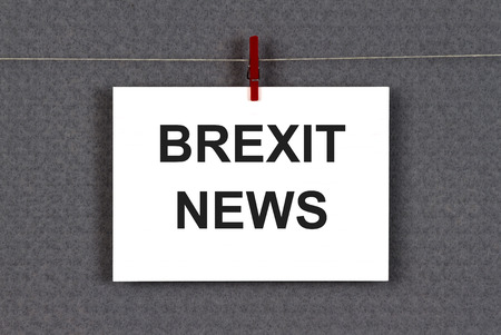 Brexit news weitten on a note clipped on a grey pinboard