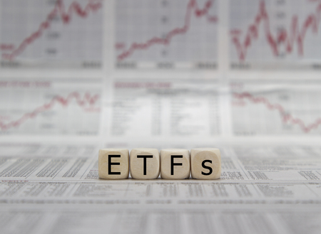 ETF exchange trades funds word on a blurred business newspaper 版權商用圖片