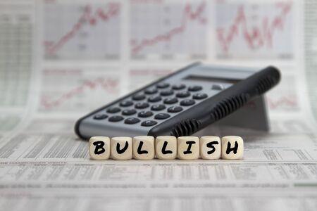 Bullish stock market word on a calculator on a business newspaper background Zdjęcie Seryjne