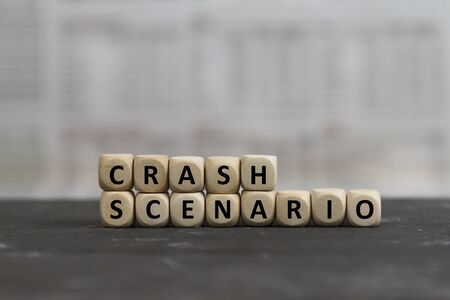 Stock market crash scenario on wooden cubes on a business newspaper