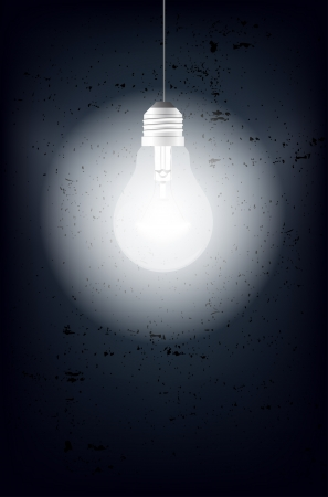glowing light bulb: Shining light bulb and grungy background - place for text