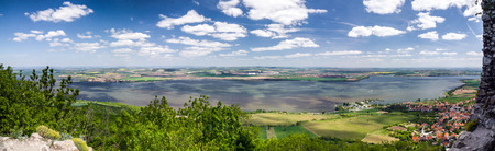 panoramic sky: Amazing spring countryside with lake, village and blue sky with clouds  Panoramic view from Palava hill - Czech Republic, Central Europe Stock Photo