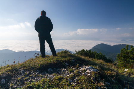 viewpoints: Hiker on a mountain top above the clouds - Choc mountains - Slovakia, Europe
