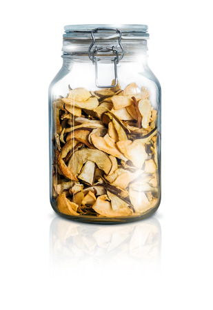 dried: Shiny glass bottle with dried fruit - isolated on white background Stock Photo