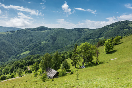 chalet: Spring mountains with old wooden chalet Svydovets Range Ukraine