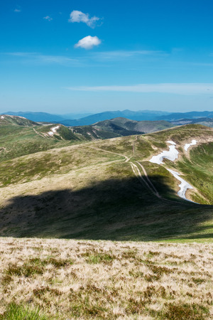 remnants: Beautiful spring Ukrainian Remnants of mountains with snow and roads under a blue sky Svydovets Range Carpathians West Ukraine Stock Photo