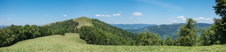 panoramic sky: Panoramic view of spring mountains with forest under blue sky Svydovets Range Carpathians West Ukraine