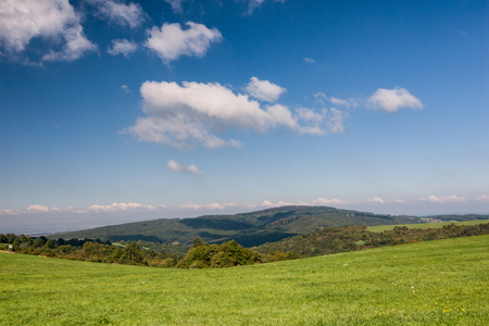 grassfield: mazing summer countryside under blue sky with clouds - White Carpathian Mountains, Czech Republic, Europe