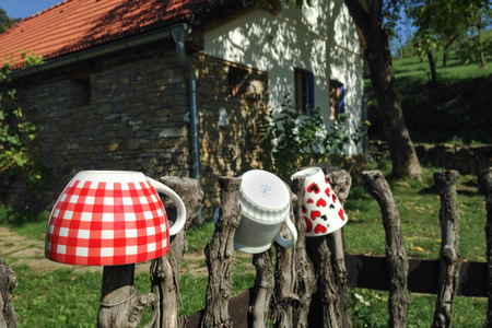 retreat: Porcelain cups on a wooden fence - rural retreat