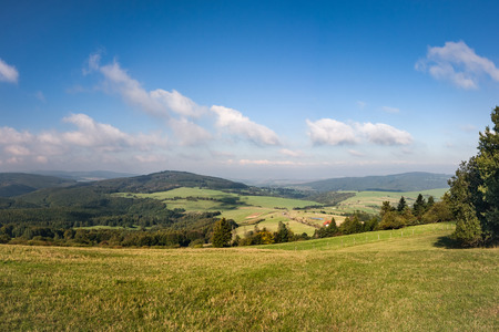 grassfield: Amazing summer countryside under blue sky with clouds - White Carpathian Mountains, Czech Republic, Europe Stock Photo