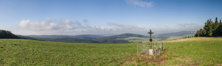 grassfield: Panorama of amazing summer countryside with metal Christian cross under blue sky - White Carpathian Mountains, Czech Republic, Europe