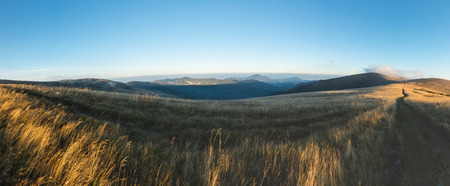 Panorama from morning grassy mountain ridge under blue sky in late summer - Greater Fatra National park, Slovakia, Europe