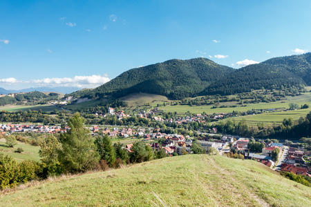 rural countryside: Village under hills and blue sky - view from Slovakia rural countryside, White Creek village near Ruzomberok city, Slovakia, Europe