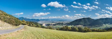 ruzomberok: Panorama of Slovakia mountain countryside - Ruzomberok city and High Tatras on horizon Stock Photo