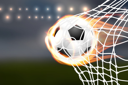 soccer goal: Flying burning soccer balloon in goal - place for your text.