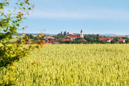 blue green landscape: Amazing spring rural landscape with green field, village and blue sky - Czech Republic, Europe