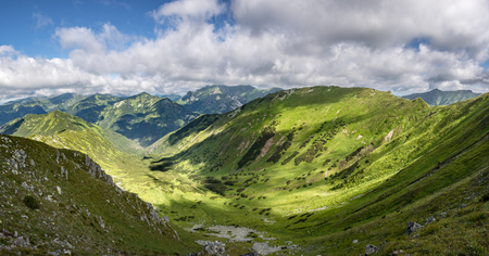 Panorama of summer mountains valley and neighbouring peaks under blue sky with clouds in West Tatras, Slovakia, Europe Stock Photo