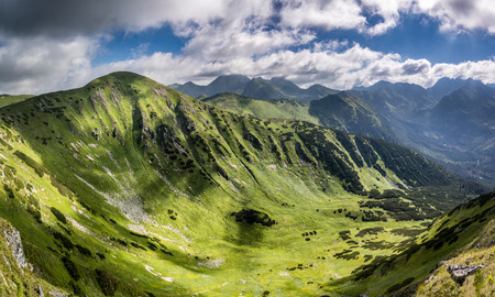 Panorama of amazing mountains valley and neighbouring peaks under blue sky with clouds - West Tatras, Slovakia, Europe Stock Photo