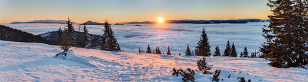 quiet: Panoramic view of amazing mountain sunrise above inversion low clouds. Little Fatra mountains, Slovakia, Europe.