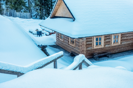 Snowy wooden cottage - Slovakia, Europe Stock Photo