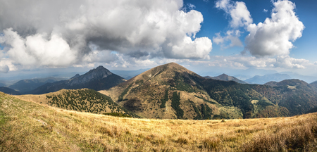 Panoramic view from slovak Little Fatra hills National Park - amazing autumn hilly landscape under blue sky with clouds
