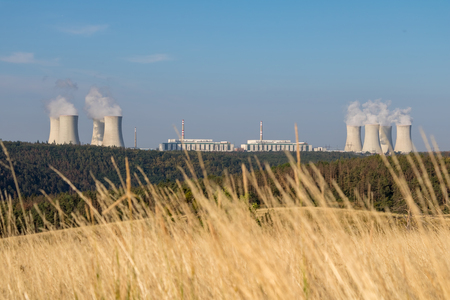 Nuclear power plant in summer landscape under blue sky. Dukovany village, Czech Republic, Europe. Stock Photo