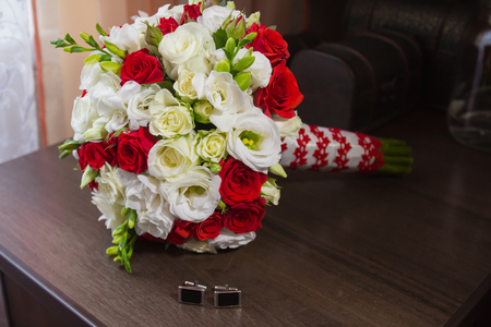 cuffs: Beautiful wedding bouquet, with cuffs on the sleeves Stock Photo
