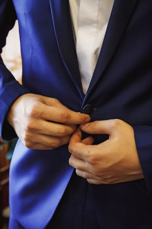 to button up: Hands Men, button up blue wedding suit Stock Photo