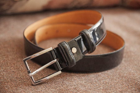 cuff buckle: Wedding mens belt, lying on the floor Stock Photo