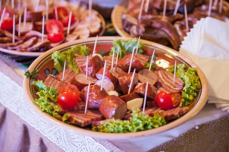 nicely: Nicely decorated, meat and fruit wedding reception Stock Photo
