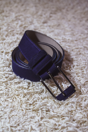 Wedding mens belt, lying on the floor Stock Photo