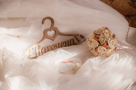 Black and white bow ties on wooden hangers Foto de archivo