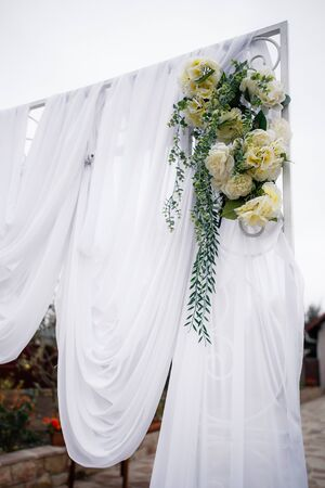 Wedding archway with flowers arranged in park for a wedding ceremony in wedding day