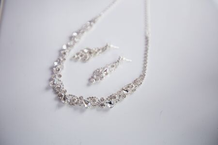 Jewelry on a marble background in wedding day. Wedding accessories.