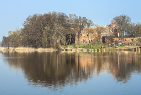 cistercian: Post Cistercian Structures in Bierzwnik village (part of Cistercian Trail in Poland) reflected in lake, Poland. Stock Photo