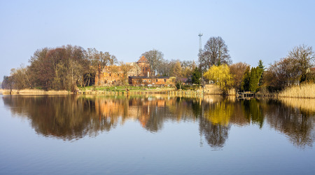 cistercian: Post Cistercian Structures in Bierzwnik village  part of Cistercian Trail in Poland  reflected in lake, Poland