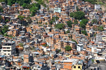 barracks: Poor houses in slum, a view on Rocinha - the biggest favela of Rio de Janeiro, Brasil   Stock Photo