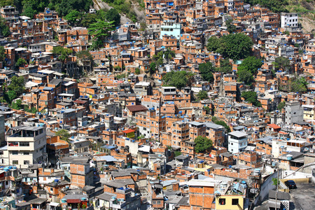 Poor houses in slum, a view on Rocinha - the biggest favela of Rio de Janeiro, Brasil   Stock Photo