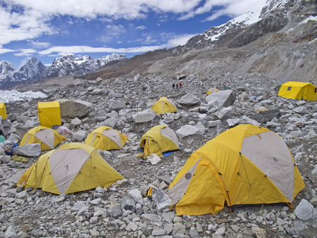 mount everest: Tents in Everest Base Camp in cloudy day  Here starts the climb to reach the top of the highest mountain in the world, Everest Region, Sagarmatha National Park, Himalayas, Nepal